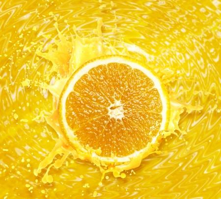 Orange juice splashing isolated on white background photo