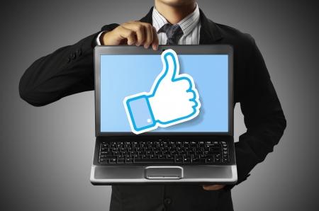 finanse: business man holding a laptop  Stock Photo