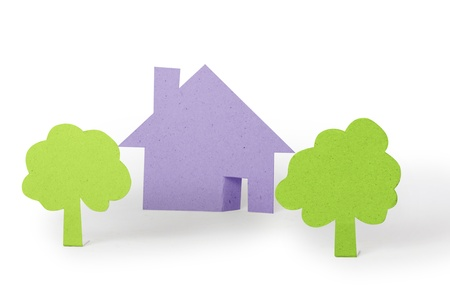 immovable property: The white paper house and paper  on White Background