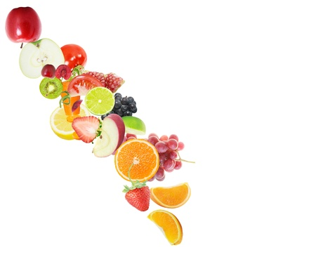 fresh juice pours from fruits on a white background  Stock Photo