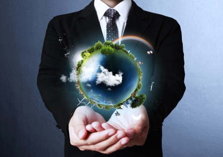 world security: holding a glowing earth globe in his hands