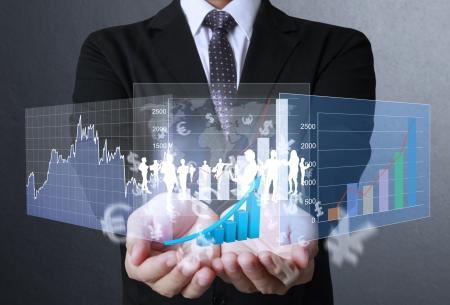 stock  exchange: hombre de negocios con s�mbolos financieros que viene de la mano