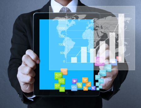 global economic crisis: touch- tablet in hands Business man  Stock Photo