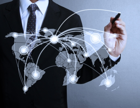 networking: Business man drawing social network structure  Stock Photo