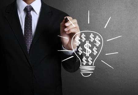 Business man drawing light bulb  photo