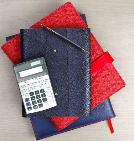 Booklet and business on a wooden table photo