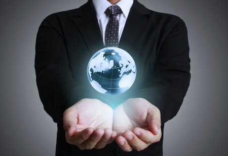 water ecosystem: holding glowing earth globe in his hands