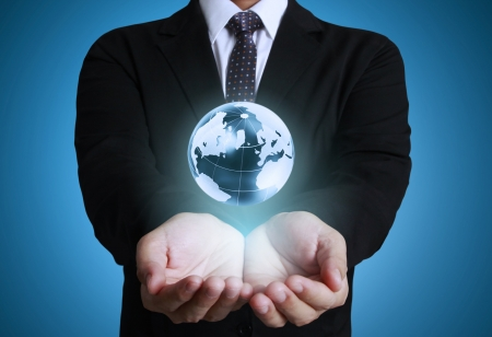 save the sea: holding glowing earth globe in his hands