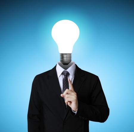 intelligent solutions: idea concept, lamp head businessman  Stock Photo