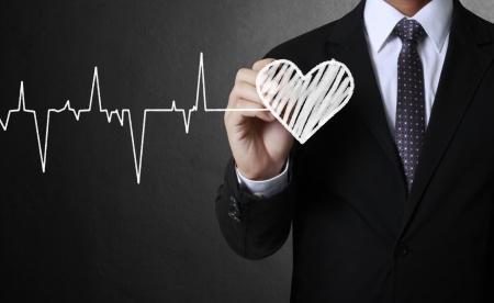 tachycardia: Business man drawing a Hand