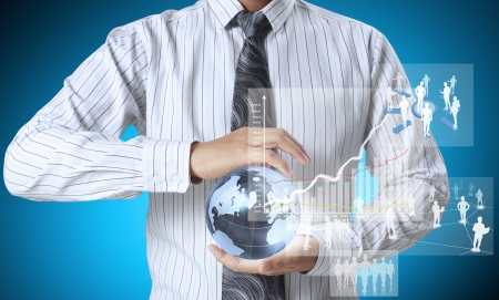 international money: holding glowing earth globe and  financial symbols coming from hand  Stock Photo