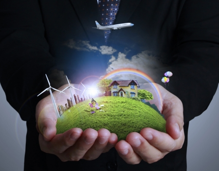 warming: wind turbine in hand businessman