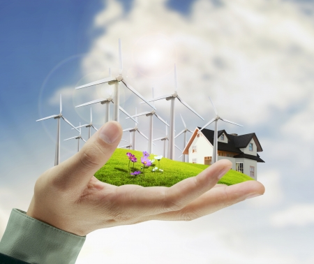 energie: Windkraftanlage in der Hand Geschäftsmann Lizenzfreie Bilder