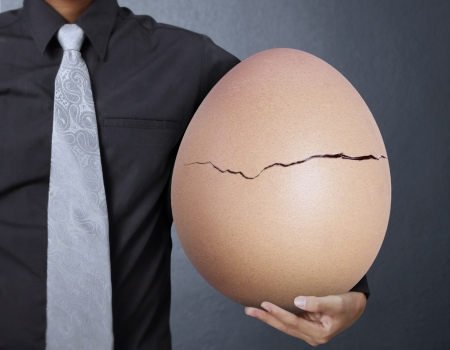 bacon portrait: businessman holding one egg in hands  Stock Photo