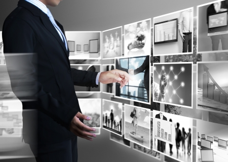 data transmission: businessmen and Reaching images streaming  Stock Photo