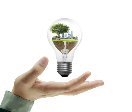 Light bulb, in a hand  Stock Photo