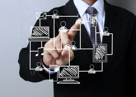 Business men hand pushing social network structure  photo