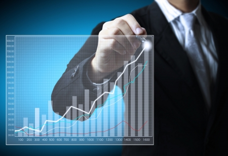 shares: Business man hand drawing a graph
