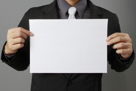a4: Business man holding the a4 paper