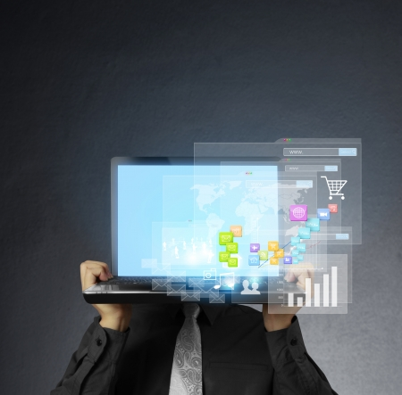 finanse: business man holding the laptop