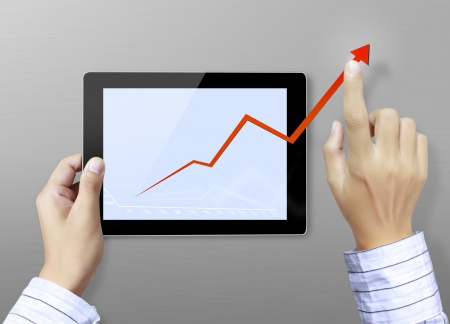 touch screen graph on tablet in hands businessmen  photo