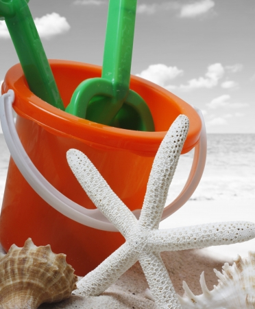spade and bucket on a beach  photo