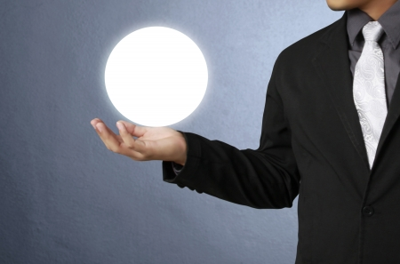holding a glowing globe in his hands  photo