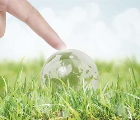 save the planet: holding a glowing earth globe in his hands
