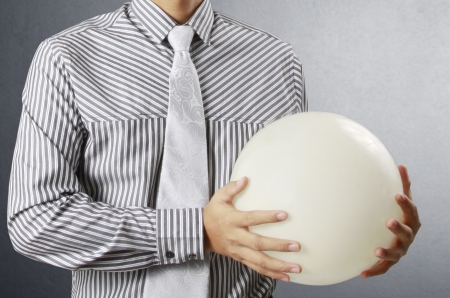 Businessman hand holding the Crystal Ball  Stock Photo - 24083361