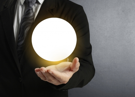 illuminate: Businessman hand holding the Crystal Ball