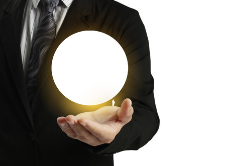 Businessman hand holding the Crystal Ball Stock Photo - 24083415