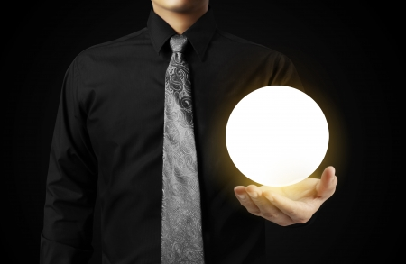 Businessman hand holding the Crystal Ball Stock Photo - 24083416