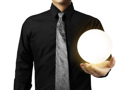 Businessman hand holding the Crystal Ball Stock Photo - 24083414