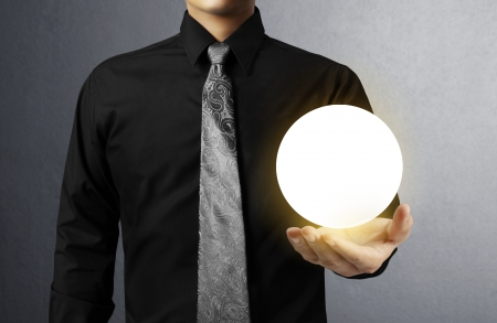 Businessman hand holding the Crystal Ball  photo