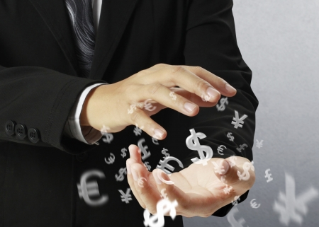 currency exchange: businessman with financial symbols coming from hand
