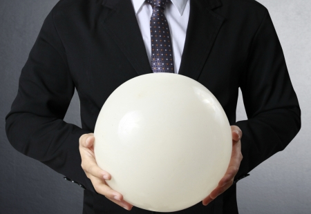 prognosticator: Businessman hand holding the Crystal Ball