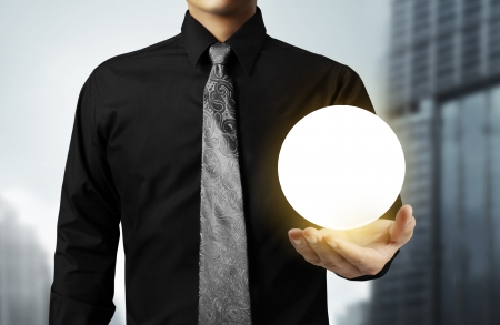 Businessman hand holding the Crystal Ball  Stock Photo - 24569170