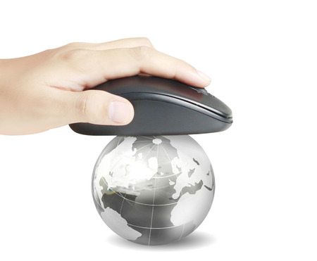 Hand with computer mouse and a globe photo