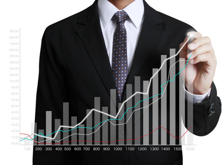 increase business: Business man hand drawing a graph