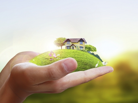 ownerships: Business man house in human hands