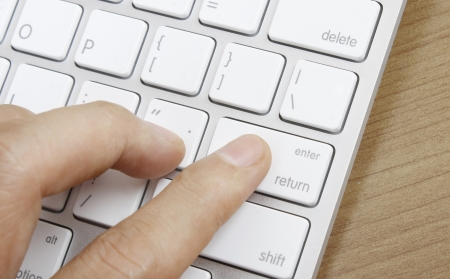 online transaction: Fingers to the keyboard buy now  Stock Photo