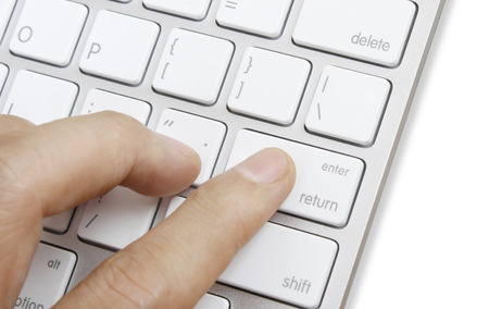 buy stock: Fingers to the keyboard buy now  Stock Photo