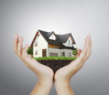 hands holding house: House model house concept in hand