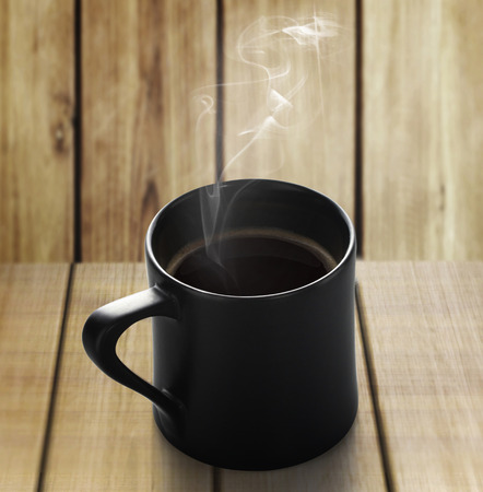 cup of coffee on a wood  photo
