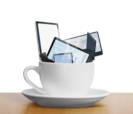 tablet touch computer gadget in a cup of coffee photo