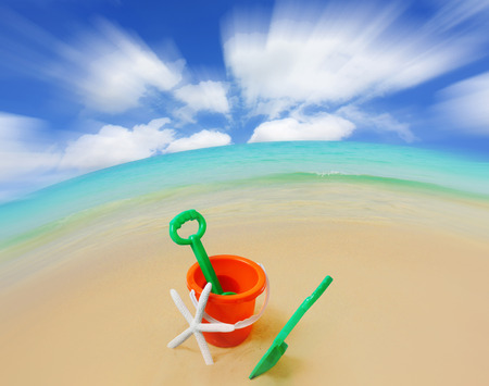 beach toys: Beach toys on the beach with sea in background
