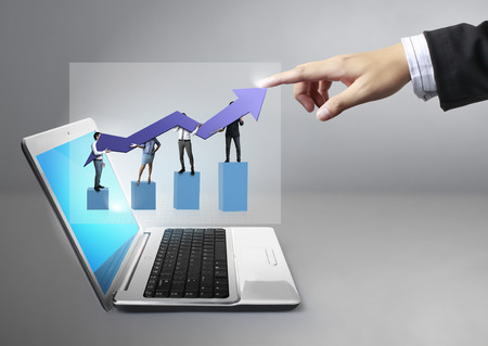 demonstrate: Hand touch business graph from laptop Stock Photo