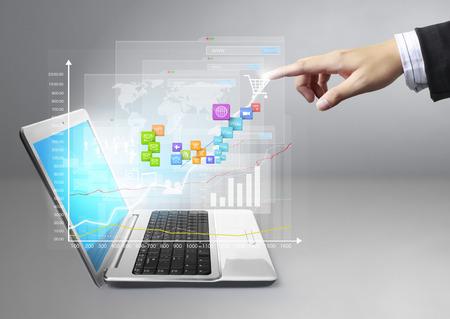 hand pushing social network symbol on laptop