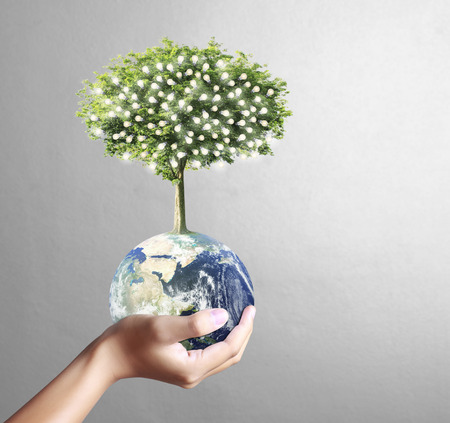 water recycling: glowing earth globe and tree in his hand