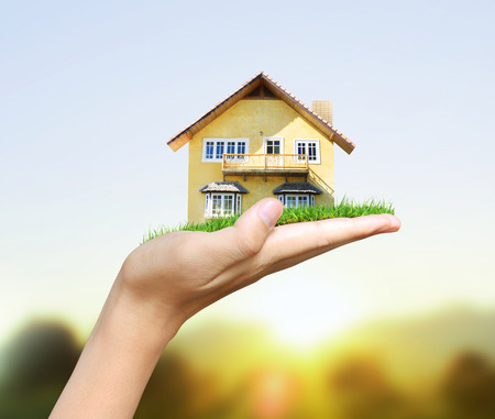 residential houses: House model  concept in the hand Stock Photo